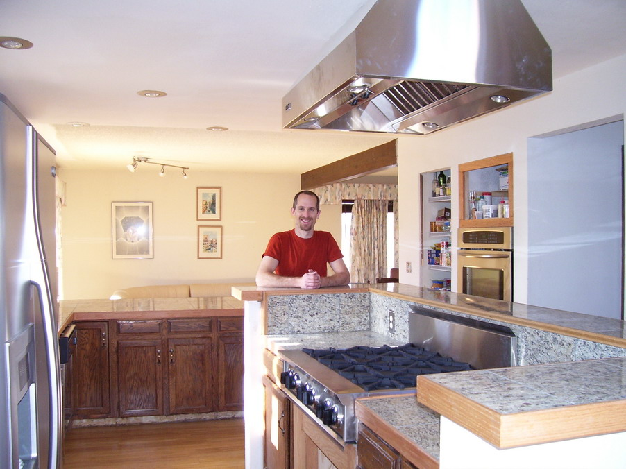 Adam Griff in his kitchen he designed and built Cooktop.jpg